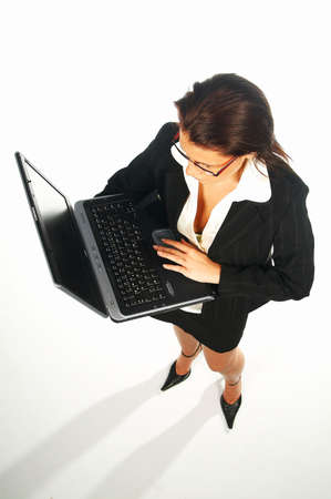 Sexy Business women isolated on white holding laptop computer Stock Photo - 375625