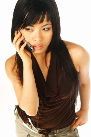Sexy asian girl model talking cell phone photo