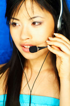telephone saleswoman: Beautiful young asian girl working as Call Center operator