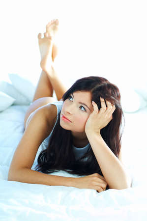 Portrait of attractive beautiful young woman on bed Stock Photo - 386755