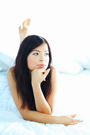 Portrait of attractive beautiful young woman on bed Stock Photo - 386753