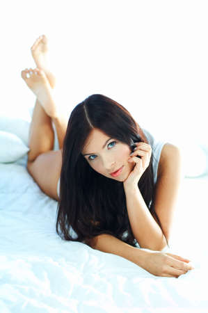Portrait of attractive beautiful young woman on bed Stock Photo - 386747