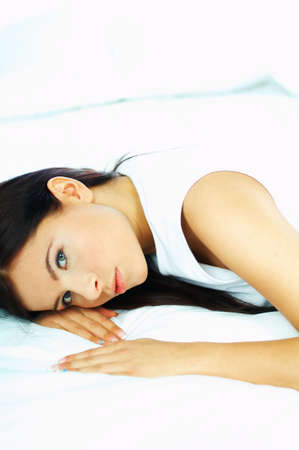 Portrait of attractive beautiful young woman on bed Stock Photo - 386741