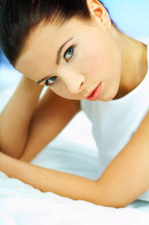 Portrait of attractive beautiful young woman on bed Stock Photo - 386727