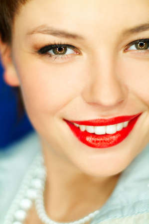 Portrait of beautiful young  smiling woman with red lipstick photo
