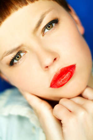 Portrait of beautiful young woman with red lipstick photo