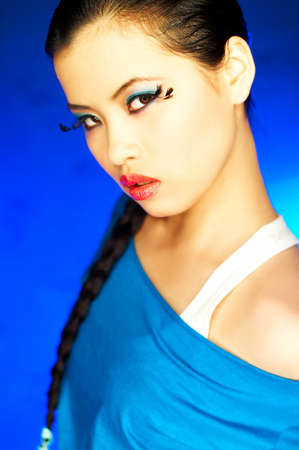 Portrait of attractive beautiful young sexy model with artificial eyelashes and impressive makeup photo