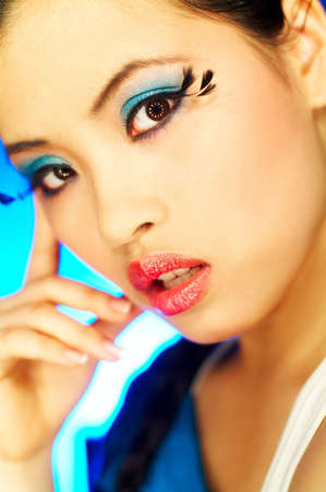 impressive: Portrait of attractive beautiful young sexy model with artificial eyelashes and impressive makeup