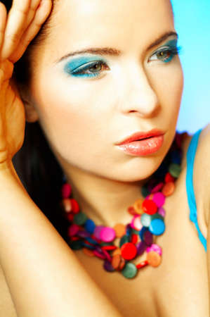 Portrait of attractive beautiful young sexy woman with blue makeup Stock Photo - 393126