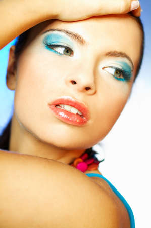 Portrait of attractive beautiful young sexy woman with blue makeup photo