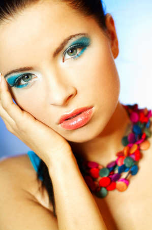 Portrait of attractive beautiful young sexy woman with blue makeup Stock Photo - 393129
