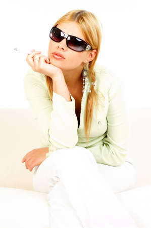 Portrait of attractive beautiful young woman with black sunglasses and cigarette Stock Photo - 409100