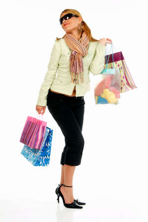 Blonde girl with hands full of bags