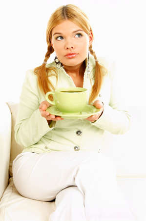 Portrait of attractive beautiful young woman with green cup od black coffee Stock Photo - 411430