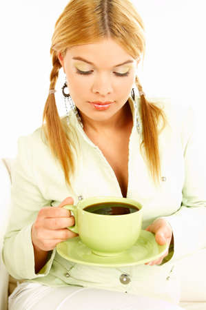 Portrait of attractive beautiful young woman with green cup od black coffee Stock Photo - 411431