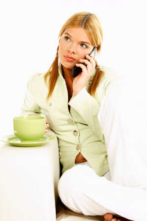 Portrait of attractive beautiful young woman with green cup of black coffee and cell phone Stock Photo - 411427