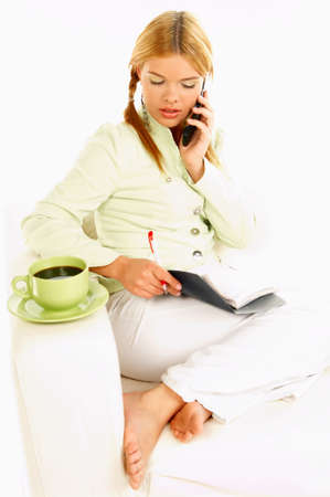 Portrait of attractive beautiful young woman with green cup of black coffee cell phone and notebook Stock Photo - 411422