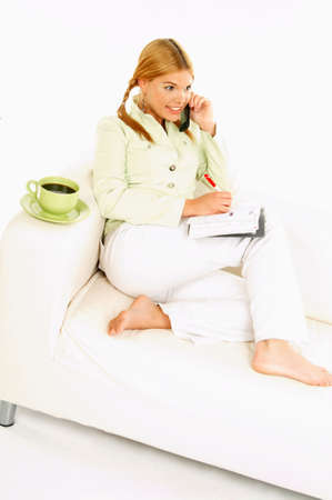 Portrait of attractive beautiful young woman with green cup of black coffee cell phone and notebook Stock Photo - 411421