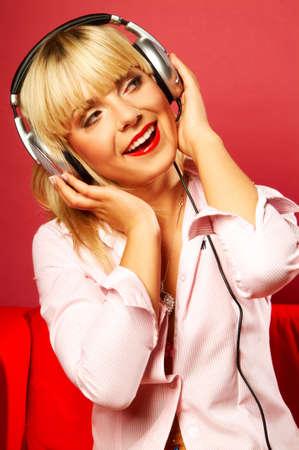 Young beautiful happy women listening music in headphones Stock Photo - 419902