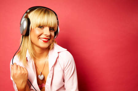 Young beautiful happy women listening music in headphones Stock Photo - 419903