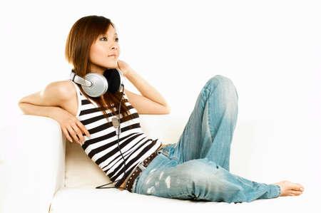 beat women: Young asian beautiful women is listening to the music