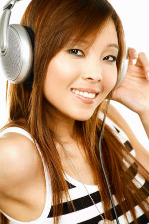 Young asian beautiful women is listening to the music photo