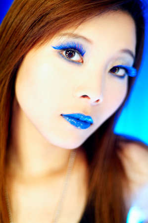 Portrait of beautiful asian girl with blue lips and eyelashes photo