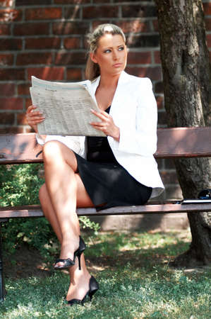 pew: Business women working reading newspaper