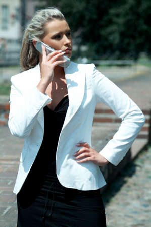 Business women talking cell phone Stock Photo - 446633