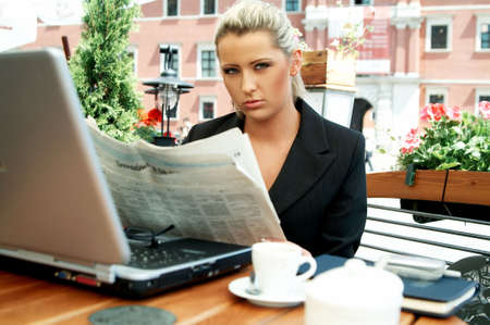 Business women reading newspaper Stock Photo - 446637