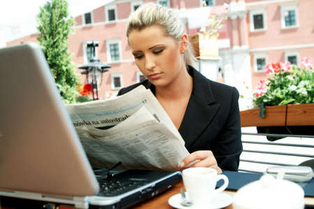 Business women reading newspaper Stock Photo - 446636