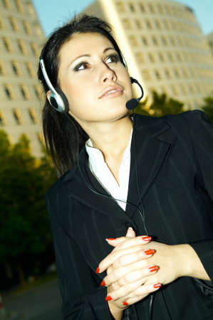 phonecall: Business woman with headphones