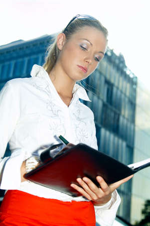 Business woman with black corporate folder Stock Photo - 453902