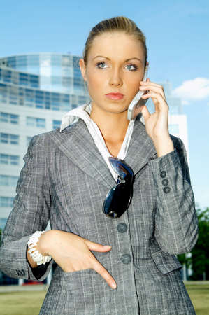 Business woman using a mobile phone Stock Photo - 453898