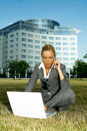 Business woman working on grass with laptop computer Stock Photo - 453895
