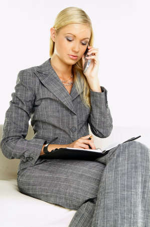 fem: Young business woman talking by phone Stock Photo