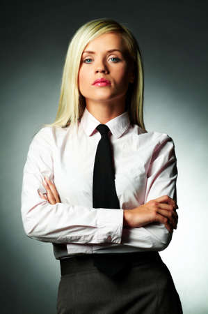 Young Business woman wearing white shirt and black tie photo