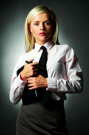 Young Business woman wearing white shirt and black tie and note book photo