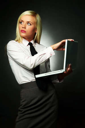 Young Business woman wearing white shirt and black tie using laptop computer photo