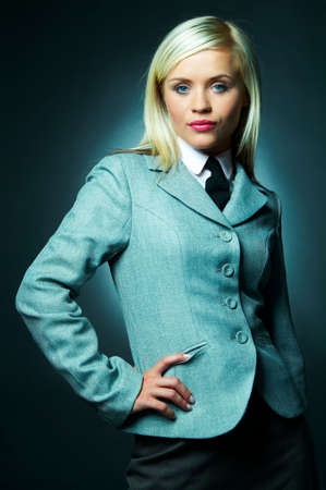 Young Business woman wearing white shirt, jacket and black tie photo