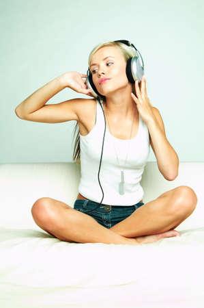 househould: Young beautiful happy women listening music in headphones