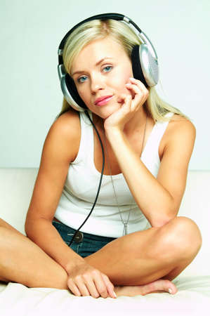 Young beautiful happy women listening music in headphones Stock Photo - 481394