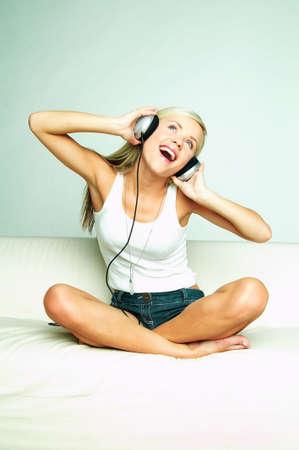Young beautiful happy women listening music in headphones Stock Photo - 481397