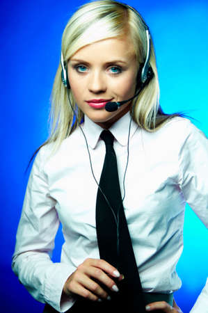 Sexy Young Business woman wearing white shirt and black tie with headset working as Call Center Agent photo