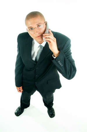 A young businessman with a blue tie and white shirt with cell phone Stock Photo - 495120