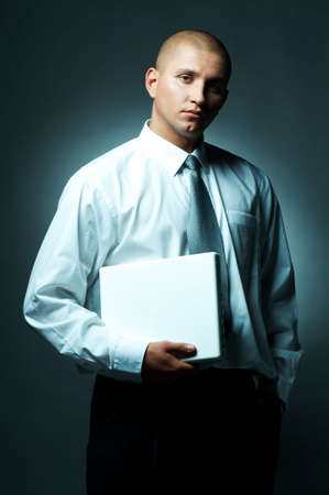 A Young businessman with laptop computer Stock Photo - 495060