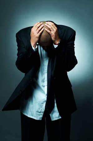 slumped: A Young businessman slumped