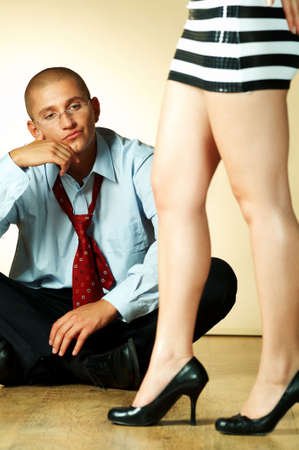 Alone businessman and womans legs around photo