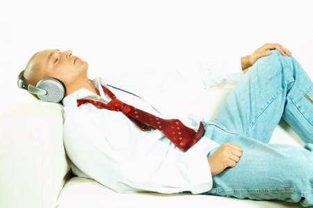Businessman relaxing on couch and listen to music photo