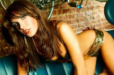 Sexy lingerie female model on blue sofa Stock Photo - 500416
